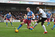 Marvin Sordell of colchester United takes close range shot at goal deflected by David Mirfin of Scunthorpe United during the Sky Bet League 1 match between Scunthorpe United and Colchester United at Glanford Park, Scunthorpe, England on 23 January 2016. Photo by Ian Lyall.