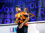 LL Cool J and Chrissy Teigen appear during the Lip Sync Battle Live at SummerStage in Rumsey Playfield Central Park in New York City, New York on July 13, 2015.