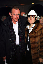 Writer MR JAMES FOX and fashion designer BELLA FREUD, at a party in London on 29th November 1999.MZN 58