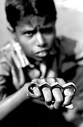 Street boy with knuckleduster Calcutta India 1990's