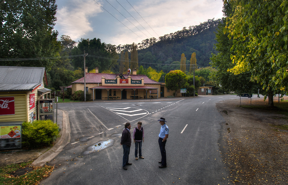 Mitta Mitta, one policeman town. Following the working life of Leading Senior Constable John Kissane. Kissane at right with Collin McGrath and Fleur Hutchinson of the Mitta Mitta Store. Pic By Craig Sillitoe CSZ/The Sunday Age.27/03/2012 This photograph can be used for non commercial uses with attribution. Credit: Craig Sillitoe Photography / http://www.csillitoe.com<br />