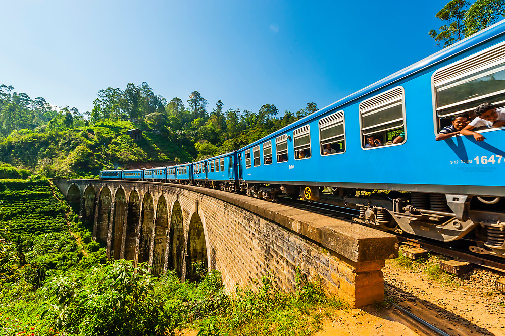 The Highland Express passes over the Nine Arch Bridge, Demodara, Ambagollapathana near Ella, Uva Province, Sri Lanka.
