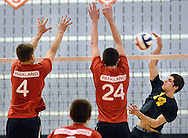 SOUDERTON, PA - MAY 31:  Central Bucks West's Jel Klapper #14 smacks the ball at Parkland's Tyler Phifer #4 and Kyle Stout #24 during the PIAA Class AAA boys volleyball quarterfinal match May 31, 2014 at Souderton High School in Souderton, Pennsylvania. (Photo by William Thomas Cain/Cain Images)