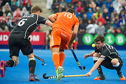 Germany's Martin Zwicker gets a deflected ball to the face from Valetin Verga of the Netherlands. The Netherlands v Germany - Final Unibet EuroHockey Championships, Lee Valley Hockey & Tennis Centre, London, UK on 29 August 2015. Photo: Simon Parker