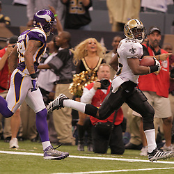 2008 October, 06: New Orleans Saints running back Reggie Bush (25) returns a punt 64-yards for a touchdown that gave New Orleans a 27-20 lead in the fourth quarter of a week five regular season game against the Minnesota Vikings on Monday Night Football at the Louisiana Superdome in New Orleans, LA.