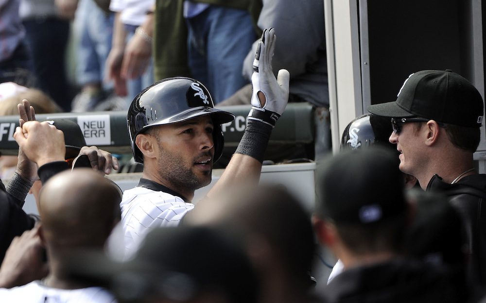 CHICAGO - APRIL 06:  Alex Rios #51 of the Chicago White Sox celebrates with teammates after hitting a home run in the sixth inning against the Seattle Mariners on April 06, 2013 at U.S. Cellular Field in Chicago, Illinois.  The White Sox defeated the Mariners 4-3.  (Photo by Ron Vesely)   Subject:  Alex Rios