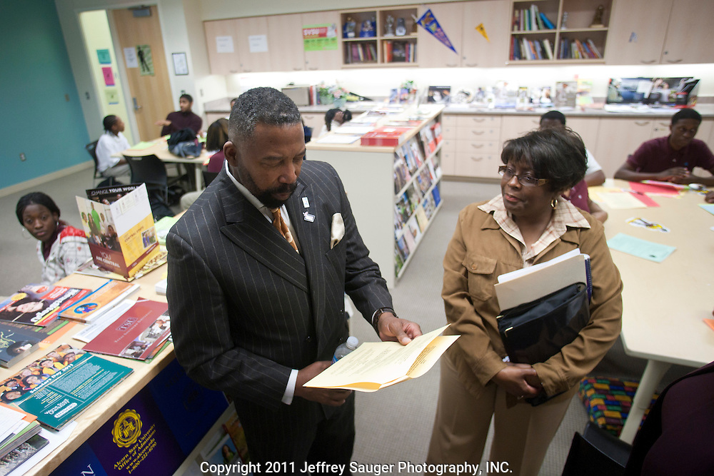 DETROIT, MI - NOVEMBER, 16: Principal Gail Russell-Jones, right,  speaks during a surprise visit from Robert C. Bobb, Emergency Financial Manager of Detroit Public Schools, left, at Renaissance High School in Detroit, MI, Tuesday, November 16, 2010. A member of Bobb's security team is at left. (Photo by Jeffrey Sauger)