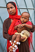 Hafiza holds her son Nafizul. Nafizul is being treated for Club Foot at the IFB Assistive Device Centre at the Chuandanga Hospital in the western region of Bangladesh.  .Impact Foundation Bangladesh (IFB) provides care, support and treatment to people with disabilities in Bangladesh.