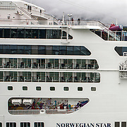 Passengers disimbark from the Norwegian Pearl at the port  in Juneau, Alaska. <br /> Photography by Jose More
