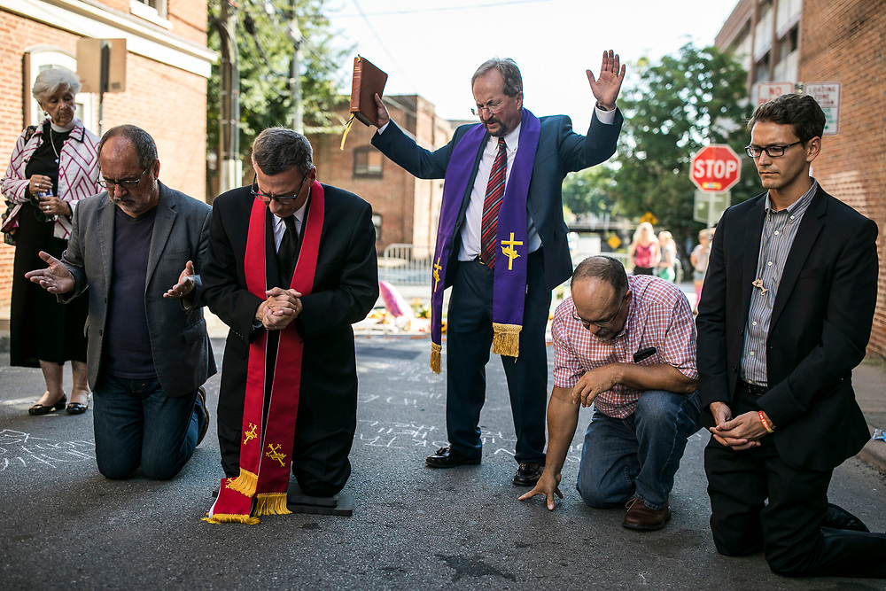 CHARLOTTESVILLE, VA. USA. August 13th 2017. <br /> <br /> Representatives from the several churches of Charlottesville gather in a Memorial for the victims at the place where a crowd was rammed by a car driver, killing Heather Heyer and injuring 35 others.<br /> <br /> James A. Fields Jr., who has voiced racist and pro-Nazi views faces the possibility of life in prison for these events.<br /> <br /> The rally occurred amidst the backdrop of controversy generated by the removal of Confederate monuments throughout the country in response to the Charleston church shooting in 2015. The event turned violent after protesters clashed with counter-protesters, which combined with the subsequent vehicle-ramming attack left over 30 injured
