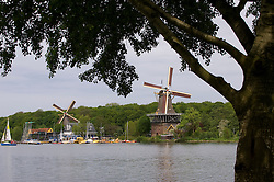 The De Lelie and De Ster snuff and spice mills. The mills, both dating from the late 1700s, sit on the waterfront of the Kralingse Bos, a man-made lake on the eastern edge of Rotterdam. (Photo © Jock Fistick)