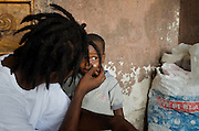 2Double, 21, spends time with his 3-year-old son, Yanky, stops by the 2-room shack where he lives with his mother and 3-year-old son in the infamous slum of Cite Soleil in Port-au-Prince, Haiti on July 19, 2008. The rap artist hopes that his music will give him the opportunity to someday move his family to a better environment.