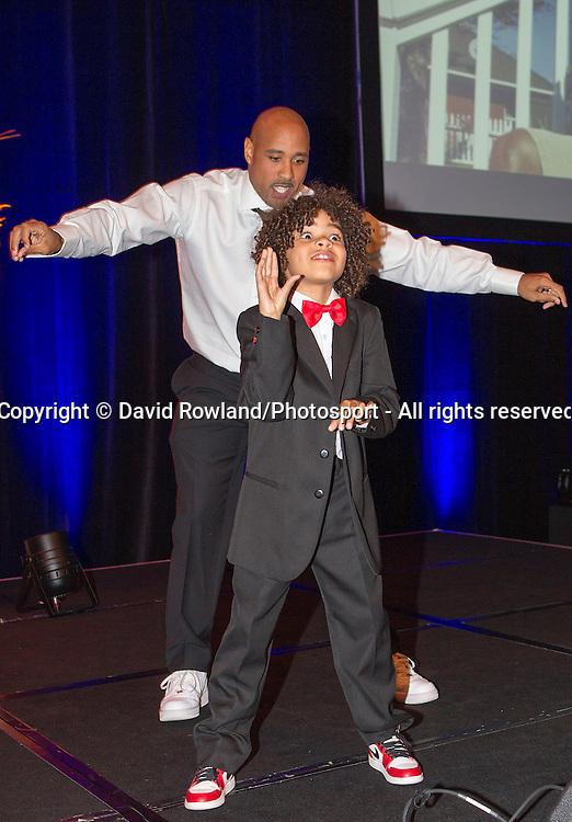 Breakers' CJ Bruton dances with son Rio at the Skycity Breakers Awards, 2013-14, Skycity Convention Centre, Auckland, New Zealand, Friday, March 28, 2014. Photo: David Rowland/Photosport