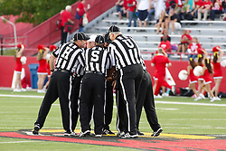 10 September 2011: game officials huddle up before the start of the NCAA football game between the Morehead State Eagles and the Illinois State Redbirds at Hancock Stadium in Normal Illinois.