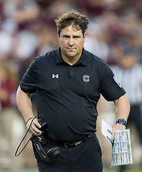 South Carolina head coach Will Muschamp rushes on to the field to check the injury of a player during the first quarter of an NCAA college football game Saturday, Sept. 30, 2017, in College Station, Texas. (AP Photo/Sam Craft)