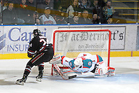 KELOWNA, CANADA - FEBRUARY 18: Adam Brown #1 of the Kelowna Rockets makes a save against Matt Dumba #24 of the Red Deer Rebels during the shoot out at the Kelowna Rockets on February 18, 2012 at Prospera Place in Kelowna, British Columbia, Canada (Photo by Marissa Baecker/Shoot the Breeze) *** Local Caption ***