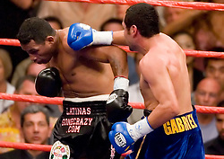 May 6, 2006 - Las Vegas, NV - Oscar DeLaHoya (r) and Ricardo Mayorga (l) trade punches during their 12 round fight for the WBC Super Welterweight Championship at the MGM Grand Garden Arena.  DeLaHoya captured the title via 6th round TKO.