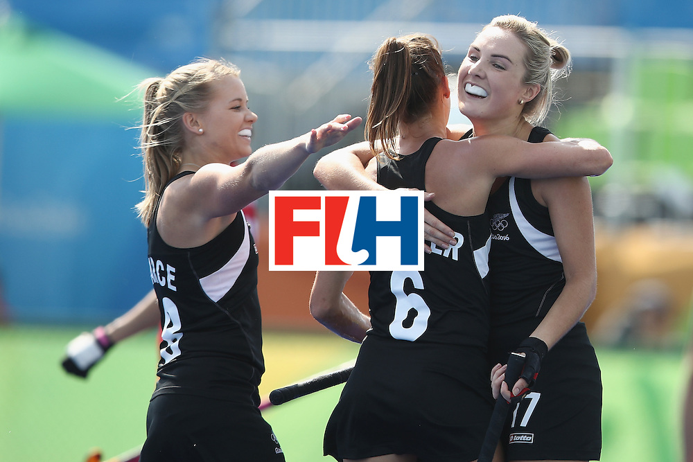RIO DE JANEIRO, BRAZIL - AUGUST 07:  Kirsten Pearce, Petrea Webster and Sophie Cocks of New Zealand celebrate Webster scoring a goal during the women's pool A match between New Zealand and the Republic of Korea on Day 2 of the Rio 2016 Olympic Games at the Olympic Hockey Centre on August 7, 2016 in Rio de Janeiro, Brazil.  (Photo by Getty Images/Getty Images)