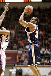Adrian Joseph shoots a 3 pointer against Virginia Tech.  Joseph had 11 points in the game, including a tie-breaking three pointer with 0:44 to help lead the Cavs to a 54-49 ACC road win.