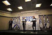 "Leader of the Israeli ""Hatnua"" party Tzipi Livni (R) and leader of the Labour party Isaac Herzog hold a joint press conference in Tel Aviv on December 10, 2014, announcing a unity deal. According to recent polls, the joint list containing Herzog and Livni, would recieve 23 mandates in the upcoming elections, as opposed to current Israeli Prime Minister Benjamin Netanyahu's Likud party, which would recieve 21. Photo by Gili Yaari"