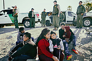 A group of migrants, all from Guatemala, prepare to be transported to a Border Patrol Station for processing after being detained after crossing the border in Yuma, AZ on Wednesday, February 6, 2019. The group said it took them 4 days to travel by bus from Guatemala to the Yuma border.(Photo by Sandy Huffaker for The Wall Street Journal)<br /> BORDER<br /> 54309
