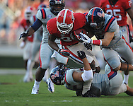 Georgia cornerback Malcolm Mitchell (26) is tackled by Ole Miss defensive back Cody Prewitt (25) and Ole Miss' Will Martin (26) at Sanford Stadium in Athens, Ga. on Saturday, November 3, 2012.