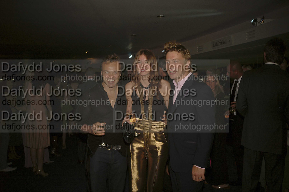 Graham Norton,  Jules  and Jamie Oliver, GQ Men Of The Year Awards, Royal Opera House, London, WC2. 5 September 2006. ONE TIME USE ONLY - DO NOT ARCHIVE  © Copyright Photograph by Dafydd Jones 66 Stockwell Park Rd. London SW9 0DA Tel 020 7733 0108 www.dafjones.com