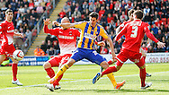 Scott Cuthbert (obscured) of Leyton Orient and Marcello Trotta of Brentford during the Sky Bet League 1 match at the Matchroom Stadium, London<br /> Picture by Mark D Fuller/Focus Images Ltd +44 7774 216216<br /> 15/03/2014