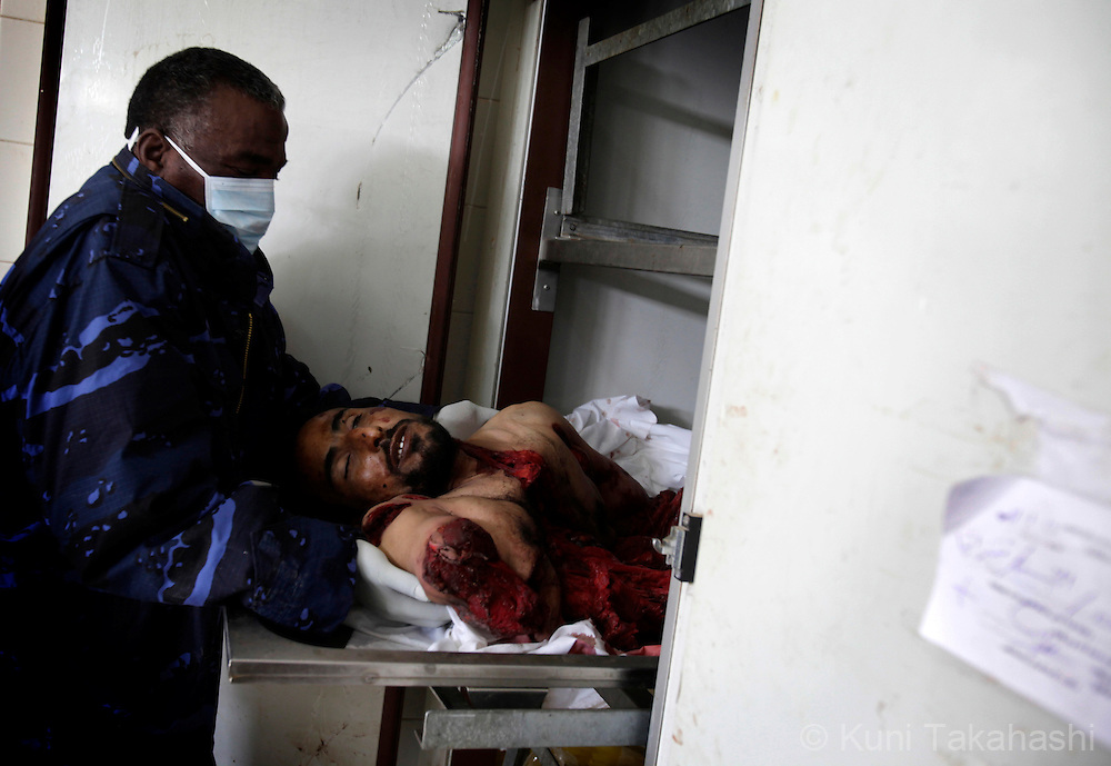 Body of a man allegedly killed by RPG (Rocket Propelled Grenade) is stored at morgue at hospital in Benghazi, Libya on Feb 25, 2011. Hundreds have died during protest against Col. Muammar Gaddafi earlier this week before the opposition took control of the city..Photo by Kuni Takahashi