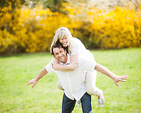 Man piggybacking woman in park