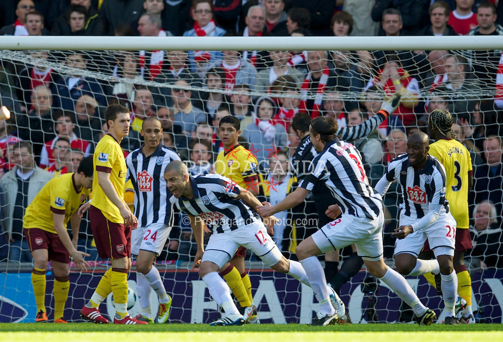WEST BROMWICH, ENGLAND - Saturday, March 19, 2011: West Bromwich Albion's Steven Reid celebrates scoring the first goal past Arsenal's goalkeeper Manuel Almunia during the Premiership match at the Hawthorns. (Photo by David Rawcliffe/Propaganda)