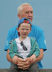 Mel Kenny with his grandson Ollie Kenny watching the Feile action in Westport on saturday last.<br />