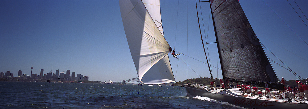 Bowman Sven Ruenow on board Wild Oats XI attaches a drop line on the spinnaker as his Yacht heads for victory in the Solas Big Boat Challenge on Sydney Harbour on December 16, 2008 in Sydney, Australia. The race conducted in the waters around Sydney Harbour, is a preliminary tournament to the Rolex Sydney Hobart Yacht race 2008 which will start of Boxing Day, December 26th.. Wild Oats XI achieved a hat trick of line honours wins when it won the Sydney to Hobart race last year equaling Morna's record achieved in the 1946-1948 races. Wild Oats XI will return to attempt a fourth successive line honours win in this years race. Photo Tim Clayton