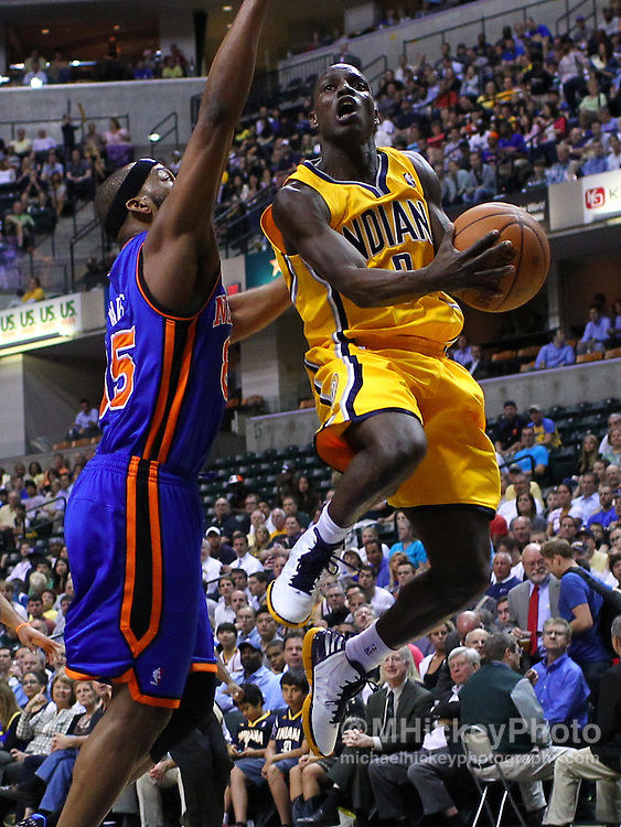 April 03, 2012; Indianapolis, IN, USA; Indiana Pacers point guard Darren Collison (2) shoots the ball against New York Knicks point guard Baron Davis (85) at Bankers Life Fieldhouse. Mandatory credit: Michael Hickey-US PRESSWIRE
