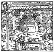 Separating lead from silver or gold in a cupellation furnace. From Agricola (Georg Bauer) 'De re metallica', Basel 1556. The Foreman consumed quantities of butter to avoid being poisoned (to prevent absorption of lead in the stomach)