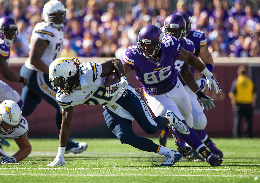 Sep 27, 2015; Minneapolis, MN, USA; San Diego Chargers running back Melvin Gordon (28) is tackled by Minnesota Vikings defensive tackle Tom Johnson (92) during the third quarter at TCF Bank Stadium. The Vikings defeated the Chargers 31-14. Mandatory Credit: Brace Hemmelgarn-USA TODAY Sports