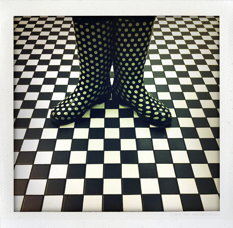 Checker floor, dotted rain boots. iPhone Picture shot in  New York City by Stefan Falke.<br />
