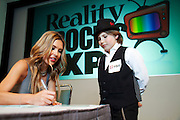 "Los Angeles, California: Audrina Partridge (The Hills) signs autographs for Donovan Dustin after a screening of her new show  at ""Reality Rocks: Los Angeles"" first reality show convention, 4/10/11 (Photo: Ann Summa)."