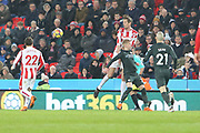 Peter Crouch climbs above Oleksandr Zinchenko during the Premier League match between Stoke City and Manchester City at the Bet365 Stadium, Stoke-on-Trent, England on 12 March 2018. Picture by Graham Holt.