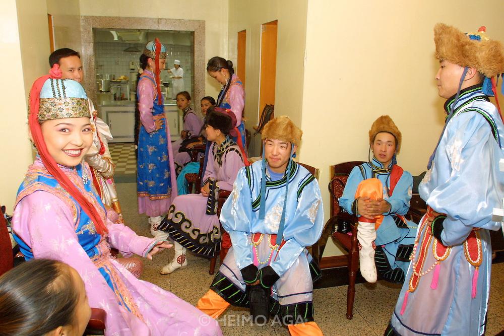 ULAN BATOR, MONGOLIA..08/22/2001.Folcloric show at Bayangol Hotel. Waiting for the performance..(Photo by Heimo Aga)