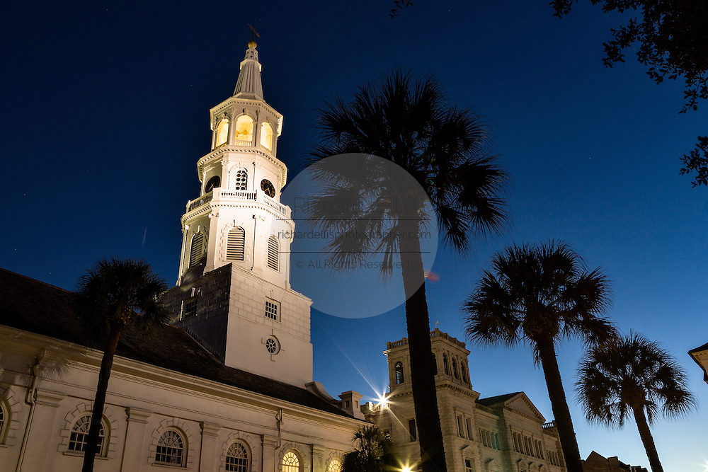Steeple of St Michaels church at twilight along Broad Street in historic Charleston, SC.