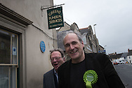 Witney, Oxfordshire, UK. 20th October 2016. Green candidate Larry Sanders, the 83-year-old brother of one-time US presidential hopeful Bernie Sanders canvasses and visits polling stations on the day of the Witney by-election following David Cameron's resignation. Pictured: Larry Sanders and his campaign manager Matt Ledbury walks past Greens Funeral Services in Witney.  // Lee Thomas, Flat 47a Park East Building, Bow Quarter, London, E3 2UT. Tel. 07784142973. Email: leepthomas@gmail.com   www.leept.co.uk (0000635435)