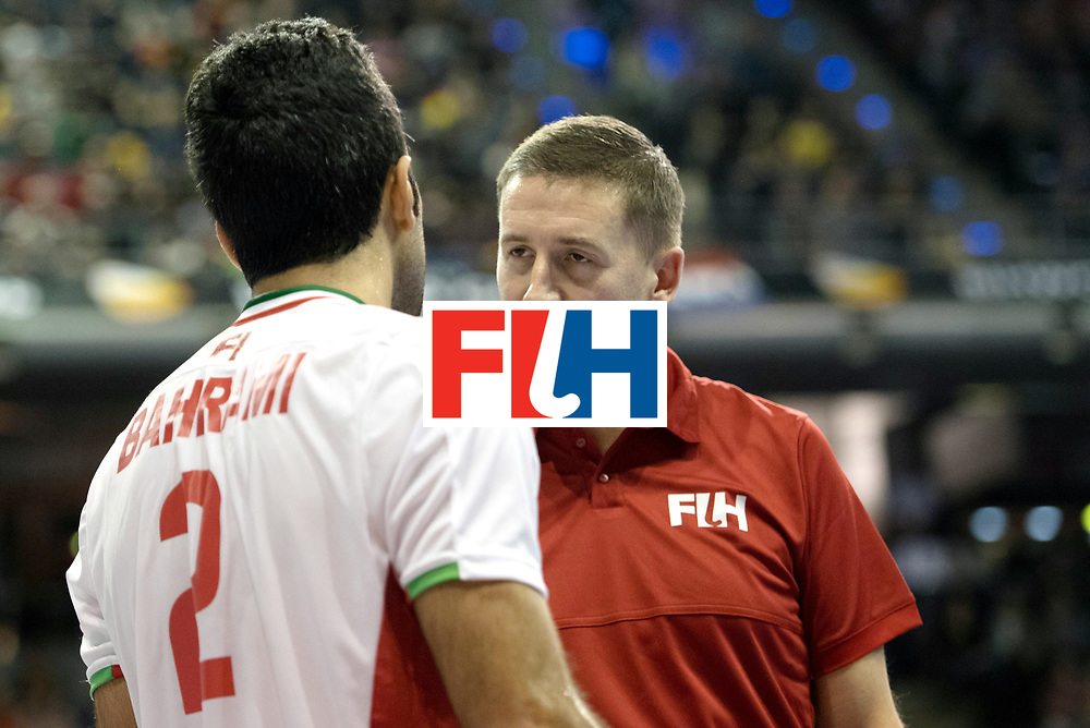 BERLIN - Indoor Hockey World Cup<br /> SF1 Germany - Iran<br /> foto: Yaghoub Bahrami and umpire Bart de Liefde<br /> WORLDSPORTPICS COPYRIGHT FRANK UIJLENBROEK