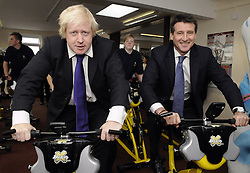 "© Licensed to London News Pictures. 17/11/2011. London, UK. Mayor of London Boris Johnson and Sebastian Coe reveal ""Get Set"" ticket spread for cacpitals schools on a visit to Bexleyheath Academy in southeast London today (17/11/2011).  The Academys gym was also opened by Sebsatian Coe chairman of LOCOG and Boris Johnson Offically opened Bexleyheath Academy. Photo credit : Grant Falvey/LNP"