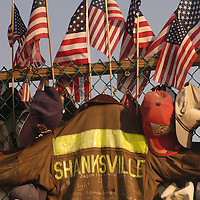 Shanksville, Pennsylvania - September 11 2003:  A Shanksville Fireman 's coat joins the flags,caps, helmets and other gifts as part of the temporary memorial  of the Flight 93 crash site. (Photo by Archie Carpenter/Getty Images)