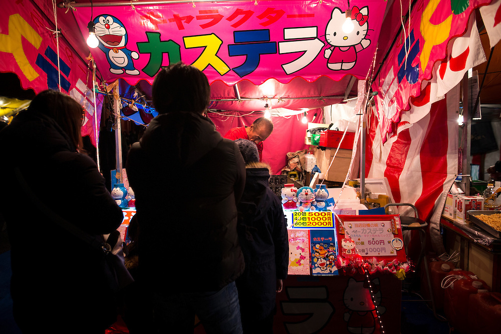 TOKYO, JAPAN - JANUARY 3 : People enjoy amusement outside Sensoji Buddhist temple at the Asakusa district in Tokyo after offering New Year prayers on Tuesday, January 3, 2017. (Photo by Richard Atrero de Guzman/NURPhoto)