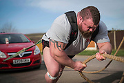Eddie Hall aka &quot;The Beast&quot; - The Strongest Man in the World.<br /> A feature following what it takes to be Eddie Hall, who has become the first Brit to win World's Strongest Man competition in 24 years. <br /> Caption: Eddie practices his technique for the truck-pull event by pulling a car with it's handbrake on.<br /> Photographer: Rick Findler / Story Picture Agency