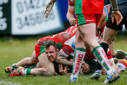 Bradford Bulls interchange George Flanagan (21) is tackled by  a number of Keighley Cougars  players during the Betfred League 1 match between Keighley Cougars and Bradford Bulls at Cougar Park, Keighley, United Kingdom on 11 March 2018. Picture by Simon Davies.