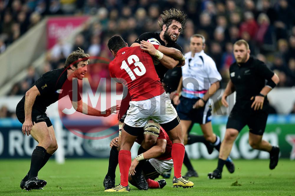 Sam Whitelock of New Zealand takes on the Tonga defence - Mandatory byline: Patrick Khachfe/JMP - 07966 386802 - 09/10/2015 - RUGBY UNION - St James' Park - Newcastle, England - New Zealand v Tonga - Rugby World Cup 2015 Pool C.