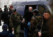 Former Yukos oil giant CEO Mikhail Khodorkovsky arrives in armoured vehicle escorted by police at a court room in Moscow, Russia. The trial begins for former oil tycoon Mikhail Khodorkovsky and business partner Platon Lebedev..Khodorkovsky's supporters claim this trial is just a new phase of a reprisal campaign driven by political calculations, commercial interests and personal motives. A new conviction and sentence would send a signal that nothing has changed despite President Medvedev's words, they say, while an acquittal would mark a break with the Putin era.
